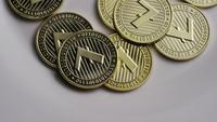 Rotating shot of Litecoin Bitcoins (digital cryptocurrency) - BITCOIN LITECOIN 0023