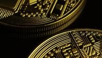 Rotating shot of Bitcoins (digital cryptocurrency) - BITCOIN 0067