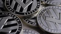 Rotating shot of Litecoin Bitcoins (digital cryptocurrency) - BITCOIN LITECOIN 0156