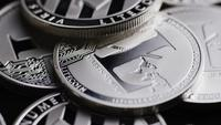 Rotating shot of Bitcoins (digital cryptocurrency) - BITCOIN LITECOIN 549