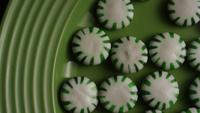 Rotating shot of spearmint hard candies - CANDY SPEARMINT 023