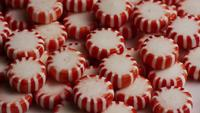 Rotating shot of peppermint candies - CANDY PEPPERMINT 060