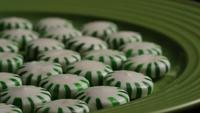 Rotating shot of spearmint hard candies - CANDY SPEARMINT 034