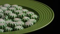 Rotating shot of spearmint hard candies - CANDY SPEARMINT 053