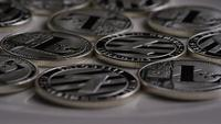 Rotating shot of Litecoin Bitcoins (digital cryptocurrency) - BITCOIN LITECOIN 0140