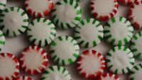 Rotating shot of spearmint hard candies - CANDY SPEARMINT 060