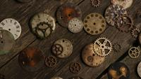 Rotating stock footage shot of antique and weathered watch faces - WATCH FACES 074