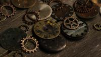 Rotating stock footage shot of antique and weathered watch faces - WATCH FACES 105