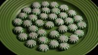 Rotating shot of spearmint hard candies - CANDY SPEARMINT 027