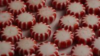 Rotating shot of peppermint candies - CANDY PEPPERMINT 028
