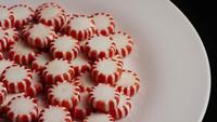 Rotating shot of peppermint candies - CANDY PEPPERMINT 059