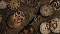 Rotating stock footage shot of antique and weathered watch faces - WATCH FACES 076