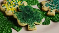 Rotating stock footage shot of St Patty's Day clovers on a white surface - ST PATTYS 015