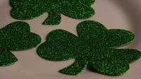 Rotating stock footage shot of St Patty's Day clovers on a white surface - ST PATTYS 008