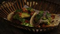 Rotating shot of delicious tacos on a wooden surface - BBQ 153