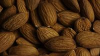 Cinematic, rotating shot of almonds on a white surface - ALMONDS 020