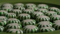 Rotating shot of spearmint hard candies - CANDY SPEARMINT 035