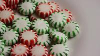 Rotating shot of spearmint hard candies - CANDY SPEARMINT 081