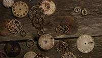 Rotating stock footage shot of antique and weathered watch faces - WATCH FACES 075