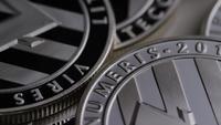 Foto giratoria de Litecoin Bitcoins (criptomoneda digital) - BITCOIN LITECOIN 0158