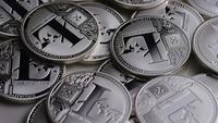 Rotating shot of Litecoin Bitcoins (digital cryptocurrency) - BITCOIN LITECOIN 0176