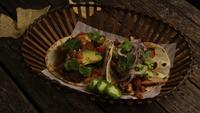 Rotating shot of delicious tacos on a wooden surface - BBQ 148