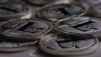 Roterande skott av Litecoin Bitcoins (digital cryptocurrency) - BITCOIN LITECOIN 0185