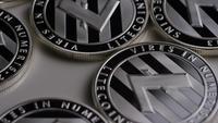 Roterande skott av Litecoin Bitcoins (digital cryptocurrency) - BITCOIN LITECOIN 0096