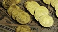 Rotating shot of Bitcoins (digital cryptocurrency) - BITCOIN 0213