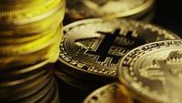 Rotating shot of Bitcoins (digital cryptocurrency) - BITCOIN 0113