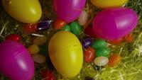 Rotating shot of Easter decorations and candy in colorful Easter grass - EASTER 004