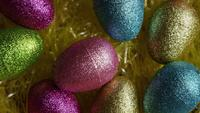 Rotating shot of Easter decorations and candy in colorful Easter grass - EASTER 012