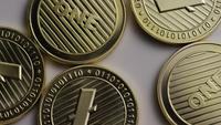 Rotating shot of Litecoin Bitcoins (digital cryptocurrency) - BITCOIN LITECOIN 0049