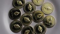 Rotating shot of Ethereum Bitcoins (digital cryptocurrency) - BITCOIN ETHEREUM 0060