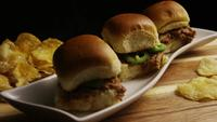 Rotating shot of delicious pulled pork sliders - BBQ 106