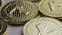 Rotating shot of Litecoin Bitcoins (digital cryptocurrency) - BITCOIN LITECOIN 0010