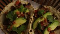 Rotating shot of delicious tacos on a wooden surface - BBQ 132