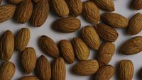 Cinematic, rotating shot of almonds on a white surface - ALMONDS 003