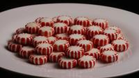 Rotating shot of peppermint candies - CANDY PEPPERMINT 067