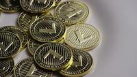 Rotating shot of Litecoin Bitcoins (digital cryptocurrency) - BITCOIN LITECOIN 0030