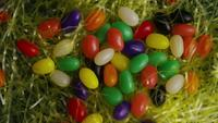 Rotating shot of Easter decorations and candy in colorful Easter grass - EASTER 006
