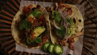 Rotating shot of delicious tacos on a wooden surface - BBQ 144