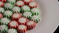 Rotating shot of spearmint hard candies - CANDY SPEARMINT 065