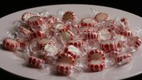Rotating shot of peppermint candies - CANDY PEPPERMINT 014