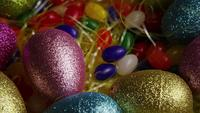 Rotating shot of Easter decorations and candy in colorful Easter grass - EASTER 022
