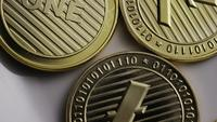 Rotating shot of Litecoin Bitcoins (digital cryptocurrency) - BITCOIN LITECOIN 0050