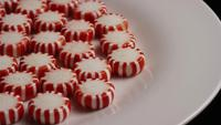 Rotating shot of peppermint candies - CANDY PEPPERMINT 034