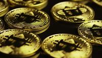 Rotating shot of Bitcoins (digital cryptocurrency) - BITCOIN 0003