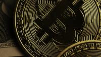 Rotating shot of Bitcoins (digital cryptocurrency) - BITCOIN 0212