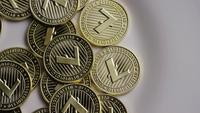 Rotating shot of Litecoin Bitcoins (digital cryptocurrency) - BITCOIN LITECOIN 0022